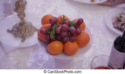 grapes and oranges on a table in the restaurant