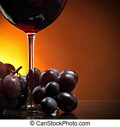 Grapes and red wine - Still-life with bunch of grapes and...