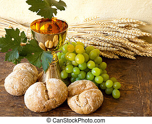 Grapes for holy wine - Grapes and holy bread next to a...