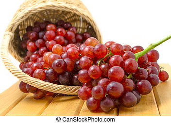 Grapes in a basket on white background