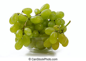 Grapes in a glass bowl, over white
