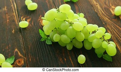 Grapes on branch on dark table - From above closeup shot of...