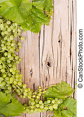 grapes on wooden plank