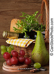 Grapes, pear and wine. - Wine, bread and herbs in a wicker ...