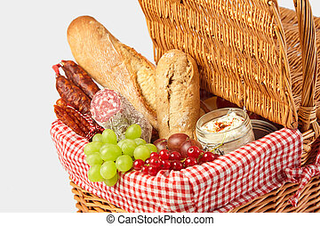 Grapes, red currant, salami and bread for a picnic