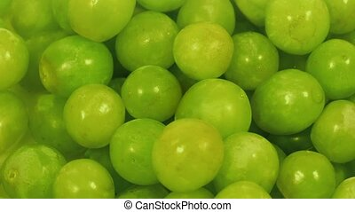 Macro shot of juicy grapes turning slowly