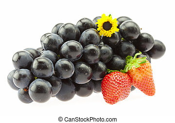 Grapes, strawberries and a flower Isolated on white