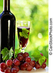 grapes with a bottle of wine and glass