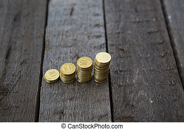 Graph from money coins on wooden table