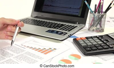 Graph Of Business Budget. Business man working with the...