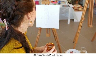 Graphic artist having a snack break drinking tea