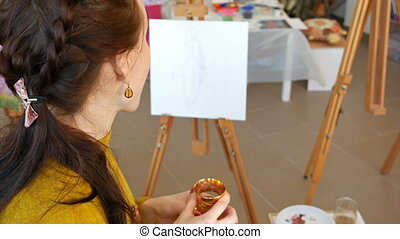 Graphic artist having a snack break drinking tea - Graphic...