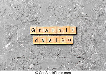 graphic design word written on wood block. graphic design text on cement table for your desing, concept