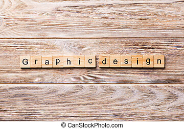 graphic design word written on wood block. graphic design text on wooden table for your desing, concept