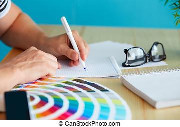 Graphic designer at sketching the design