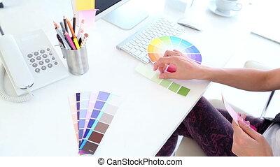 Graphic designer looking at colour