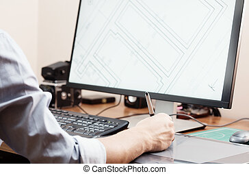 Graphic designer using digital tablet and computer in office or home. Creative process. People at work.