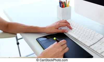 Graphic designer using digitizer in creative office