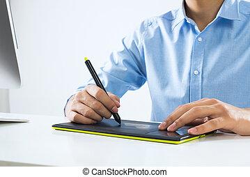 Graphic designer - Young graphic designer sitting at desk...