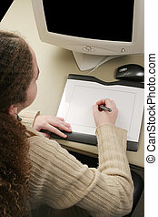 Graphics Tablet Vertical - A vertical view of a girl working...