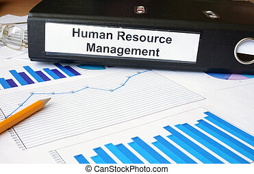 Graphs and file folder with label Human Resource Management. Business concept.
