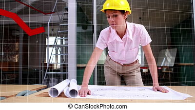 Graphs data moving against female architect looking at blueprints on the table