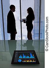 Graphs On Digital Tablet In Office