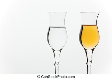 Grappa in glasses - Two different kinds of italian grappa