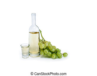 Grappa - Open bottle of grappa near wineglass and bunch of ...