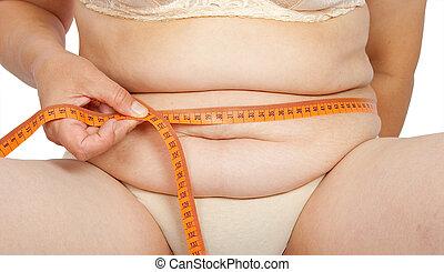 grasa, mujer, medición, ella, estómago