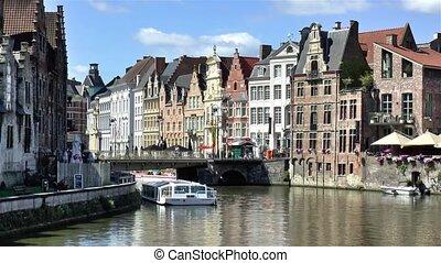 Grasbrug Bridge and traditional houses and buildings along the Leie River in Ghent, Belgium. Image captured from Vleeshuisbrug Bridge.