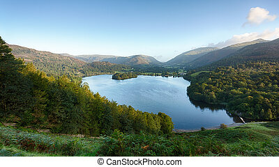 Overlook of Grasmere in Lake District as sunrise as sun light mountains