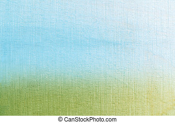 Woodgrain photograph tinted with blue and green colours, softly merging together at horizon to create an abstract painterly grass and sky textured background.