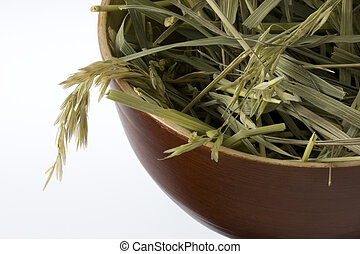 grass hay in a wooden bowl