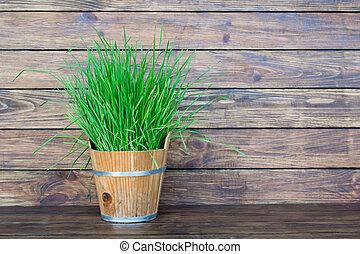 grass in a wooden bucket