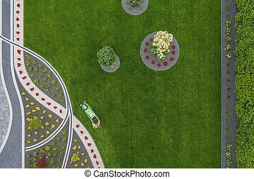 Grass Mowing Job in the Residential Front Yard Garden Aerial View