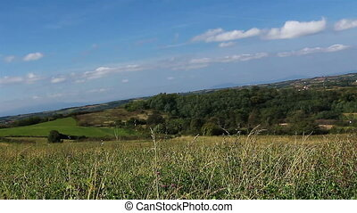 Grass on hilly landscape - Scenic view at hilly landscape on...