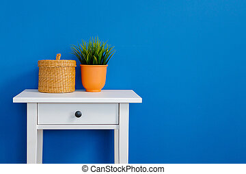 Grass plant in pot on a white table