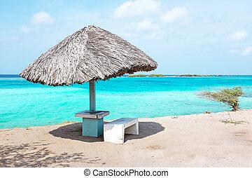 Grass umbrella at the beach on Aruba island