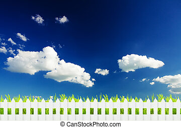 Grass with fence over sky
