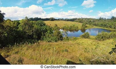Grasslands at Khao Yai National Park. - Timelapse pan video...