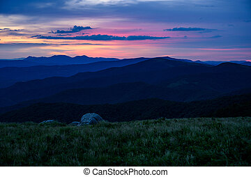 Grassy Field Over Blue Ridge Mountains At Sunset