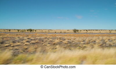 Grassy field while moving fast - A wide shot of a grassy...