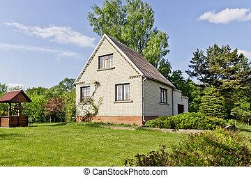 Grassy green lawn near village houme - Grassy green lawn and...
