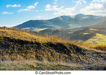 grassy hill in autumn mountains. lovely countryside. distant...