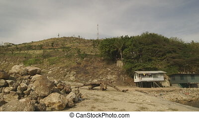 Grassy Hill, Large Rocks and Homes - Steady, low angle, wide...