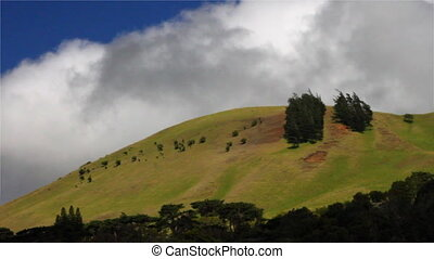 Grassy Hill Time Lapse - Time lapse of a grassy hill with...