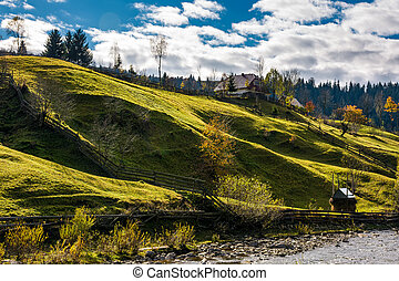 grassy rural hillside near the village in autumn. beautiful...