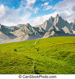 grassy slopes and rocky peaks composite. gorgeous summer...
