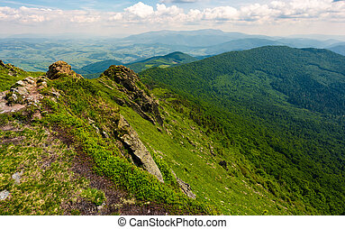grassy slopes of mountain ridge with rocky cliffs. beautiful...